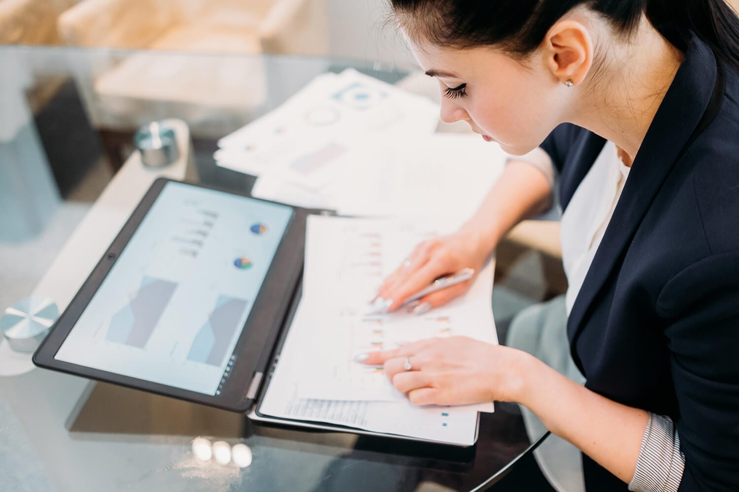 Woman working on documents in detail