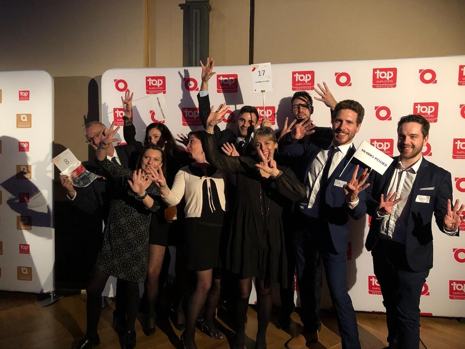 Team of people celebrating their award
