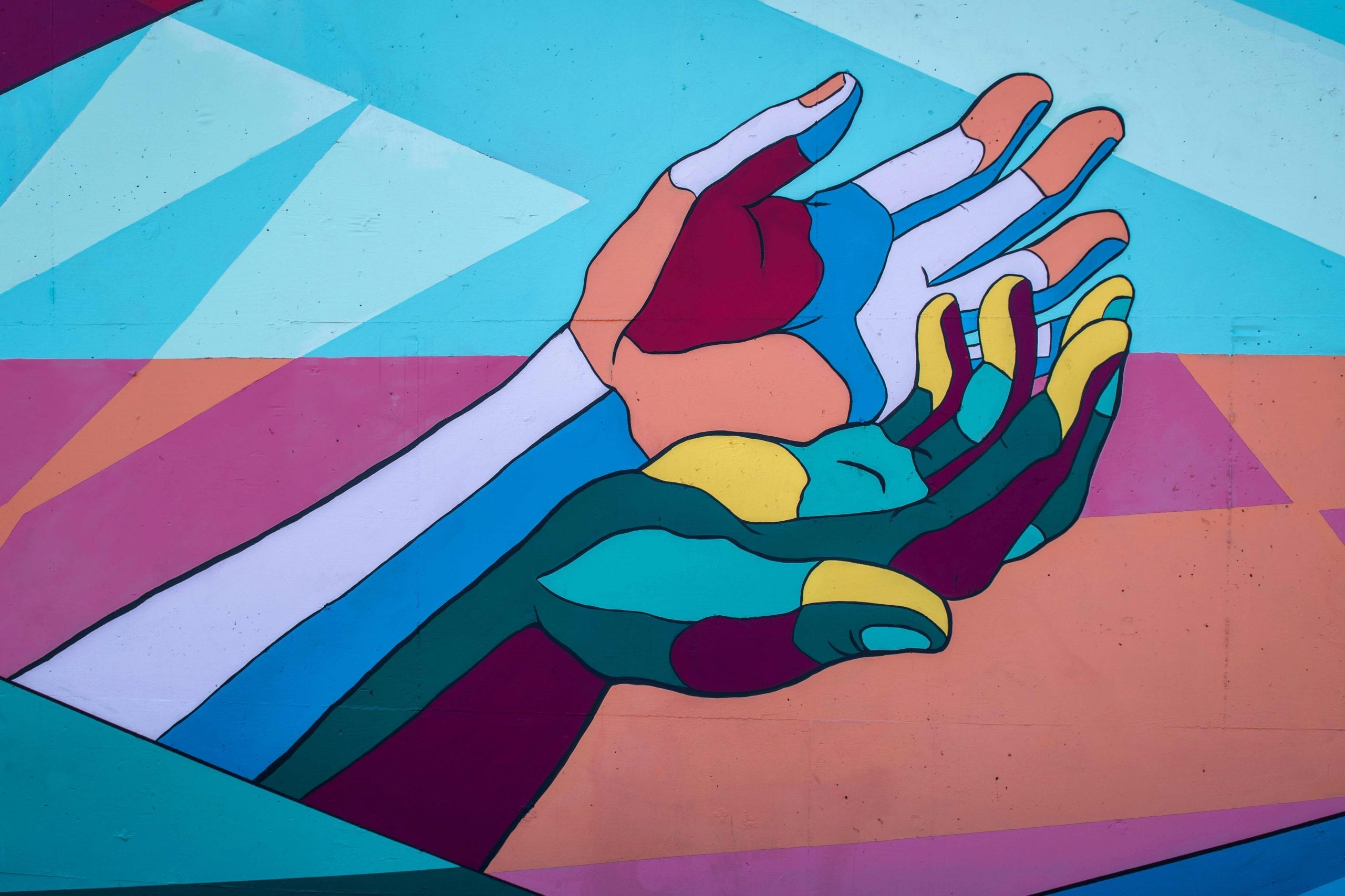 colored hands holding each other