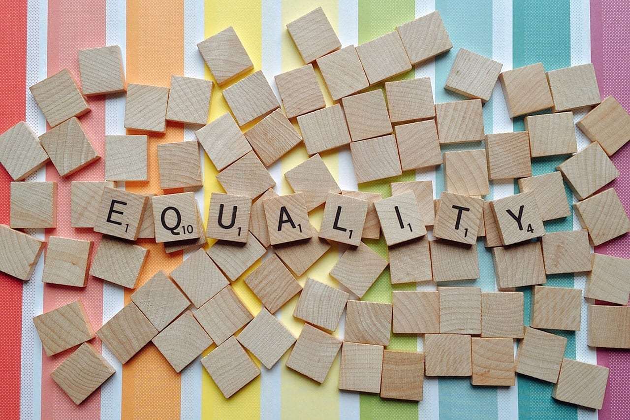 Scrabble letters with equality written