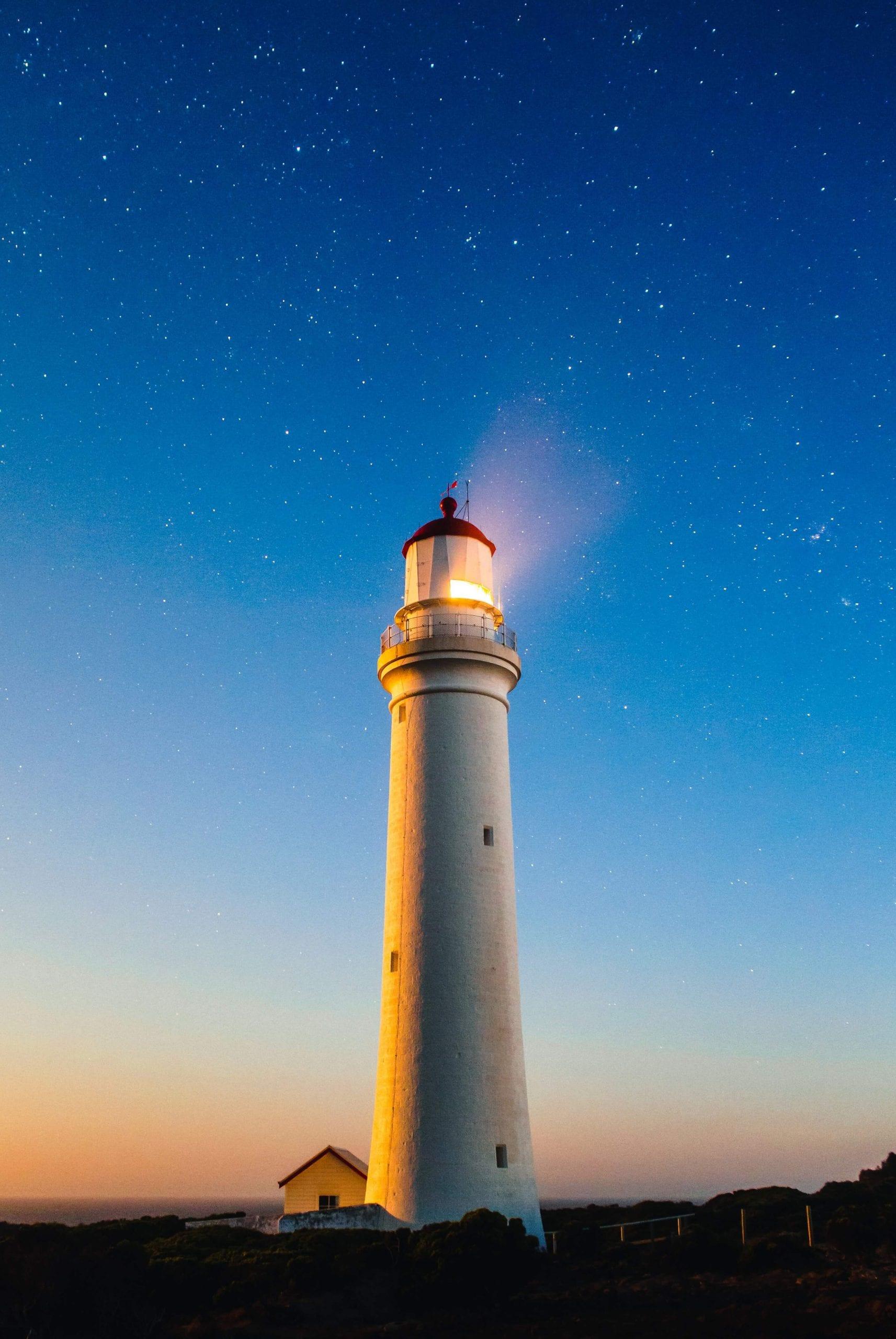 Lighthouse on a night sky
