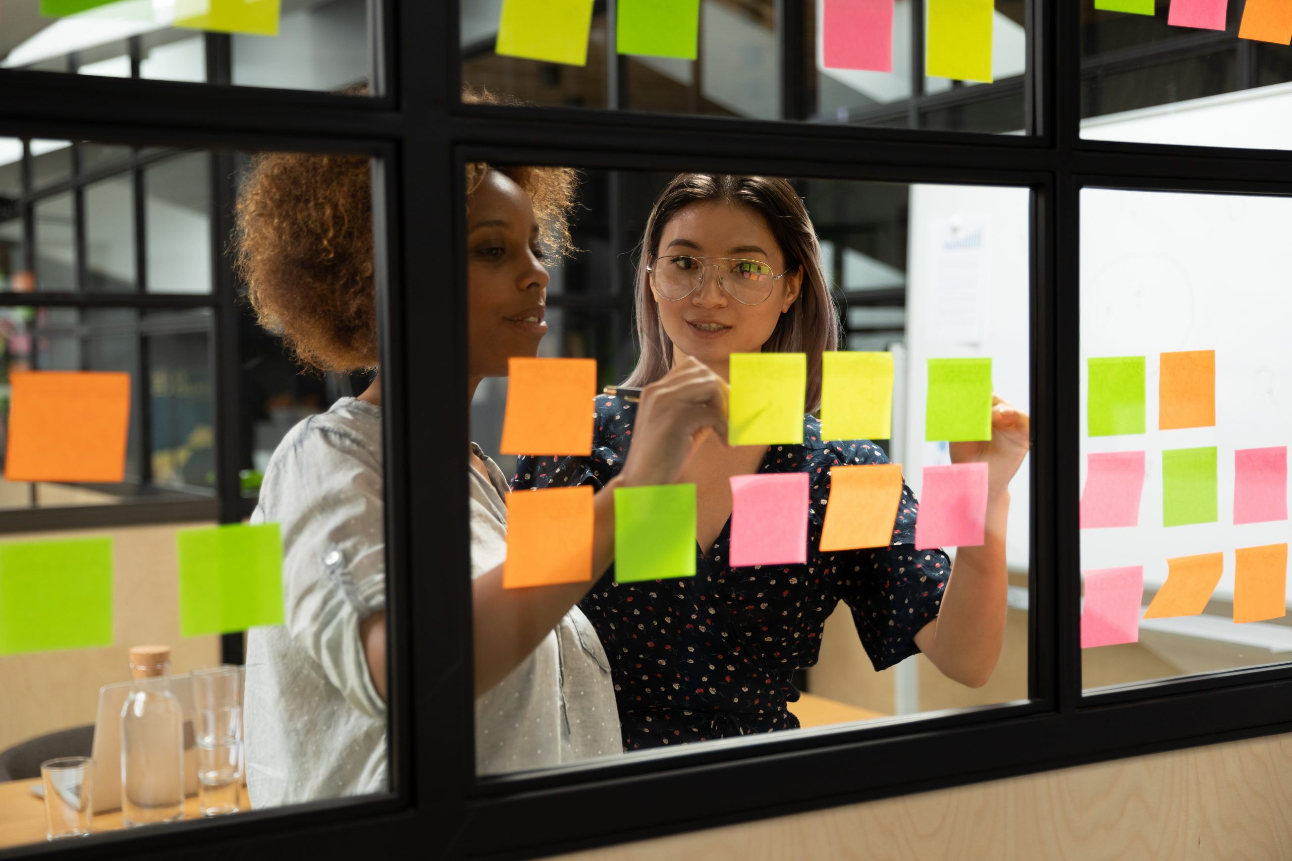 two women in front of Kanban